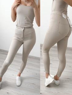Kõrge pihaosaga beežid püksid